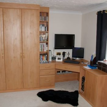 Fitted wardrobe with corner angled desk and shelves