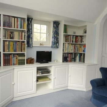Fitted bedroom furniture with cupboard drawers and shelves