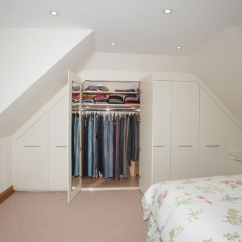 Internal storage with shelves for slanted ceiling